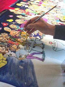 schilder zet alle karikaturen stuk voor stuk op 1 groot vel papier van 1,5 m.